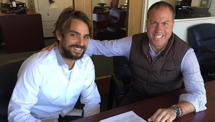 Niko Kranjčar signing the deal in New York