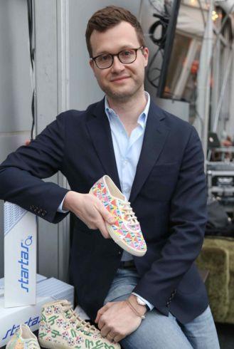 Robert Grgurev, President, Startas USA, holding handmade Startas sneakers made in Vukovar