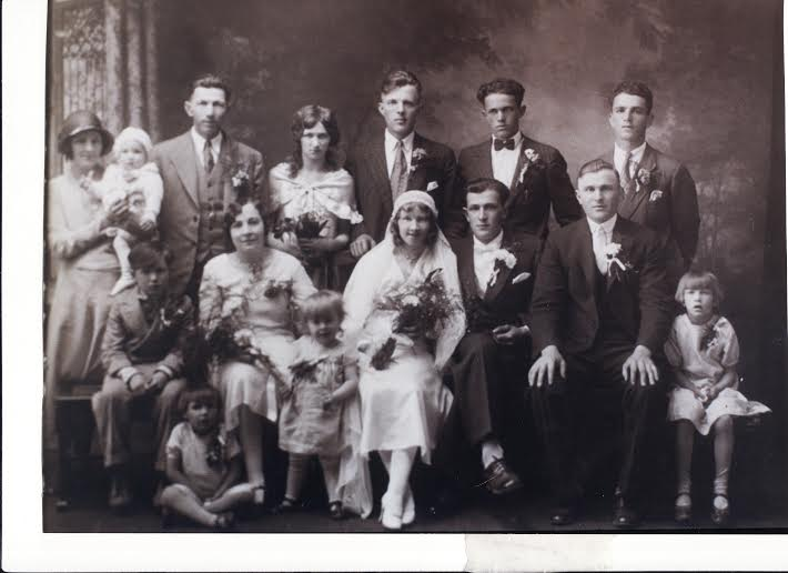 Nikola Krmpotich, Mary Krmpotich Stilin Doucette, Mary McBurnie Krmpotich (wife of Frank Krmpotich) unknown?, Tom Bahun, Frank Krmpotich, Mate Pavelich. Centre Row: Dorothy Pavelich Thorp Trudell, Anka Krmpotich [Annie], Zora Stilin Pavelich Krmpotich [Rose]. Front Row: Matthew Pavelich and John Muretic