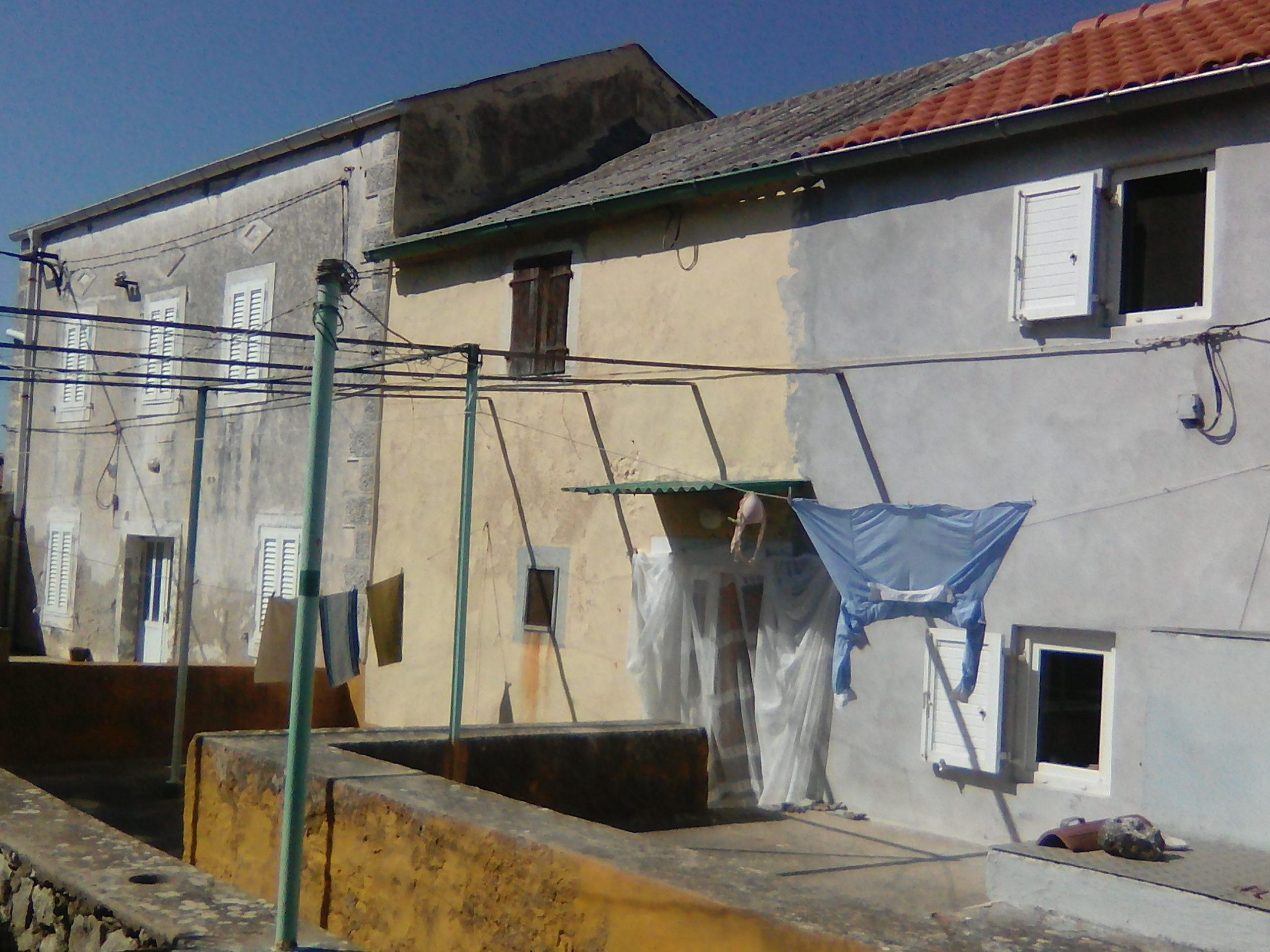 A sun-filled courtyard on Premuda.