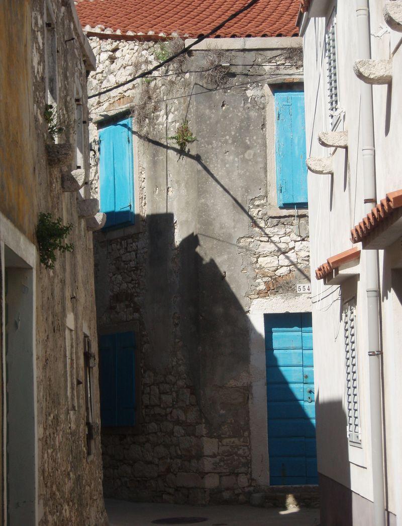 One of the stairways leading toward Susak's upper village.