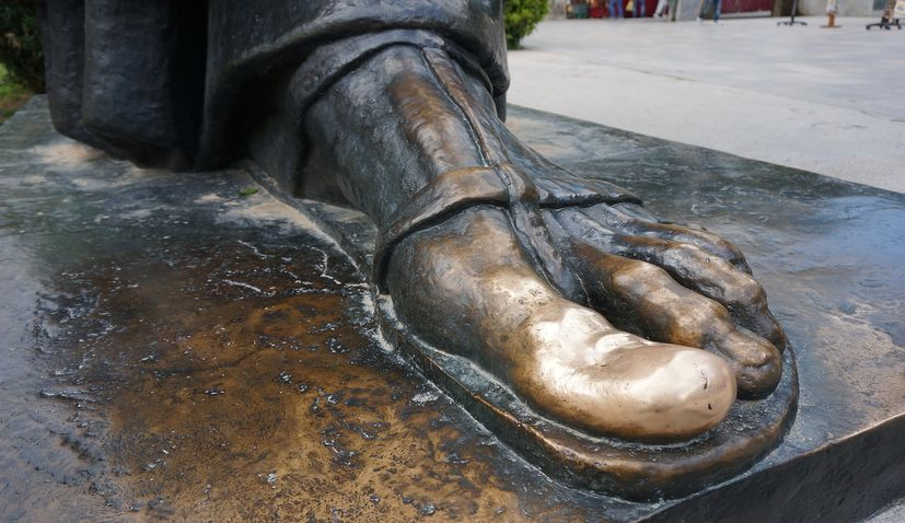 Rubbing the toe of Grgur Ninski for luck: Do you know you can do this in 3 places in Croatia?