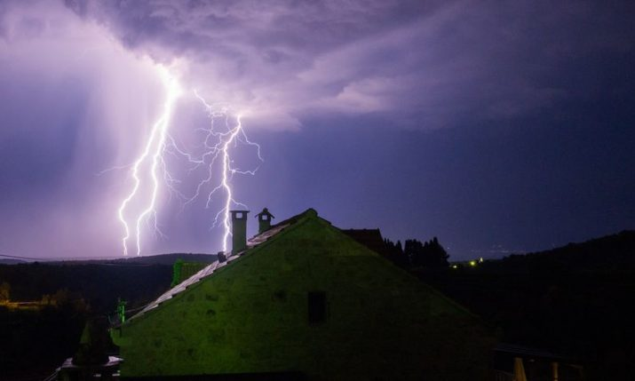 Lightning damages church bell tower on island of Brač, debris hits cars and roofs